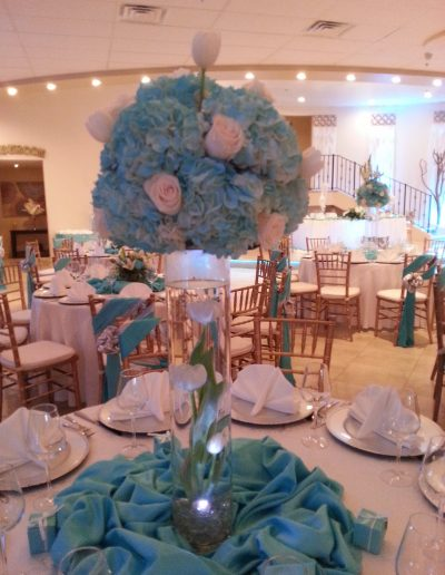Blue carnation and white rose on glass vase table arrangement