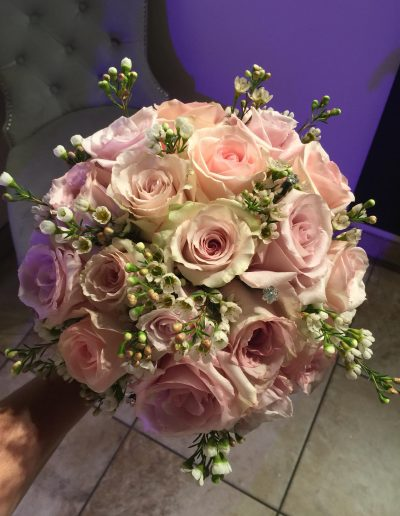 Bridal bouquet of pink and cream roses