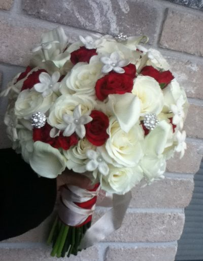 Bridal bouquet with red and white roses wrapped up