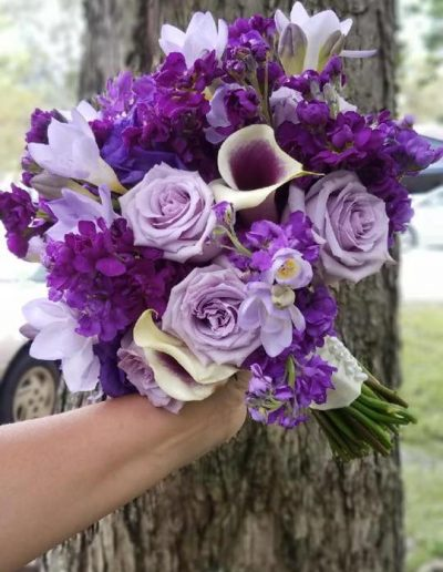 Bridal wedding bouquet of purple flowers roses,