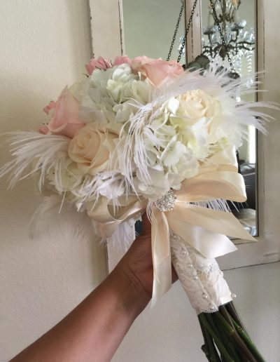 Bridal wedding bouquet with pink, cream roses and White hydrangeas and ostritch feathers