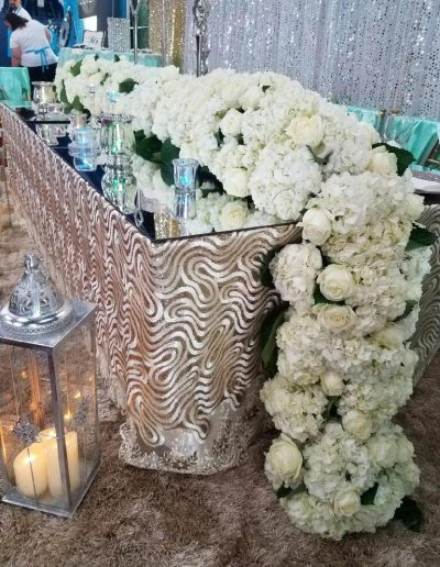 Centerpiece covered in White garden roses and white hydrangeas