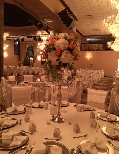 Tall white carnation and pink rose table arrangements