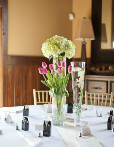 Wedding Table arrangement of White Hydrangeas and Pink tulips
