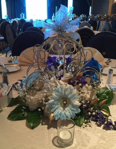 Wedding centerpiece that Looks Like Cinderella carriage Blue and white flowers