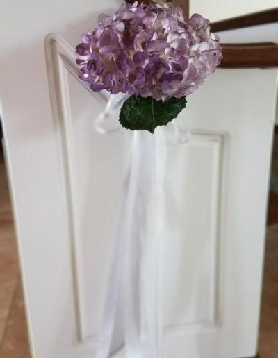 Wedding ceremony isle end piece simple purple Carnation and ribbon design