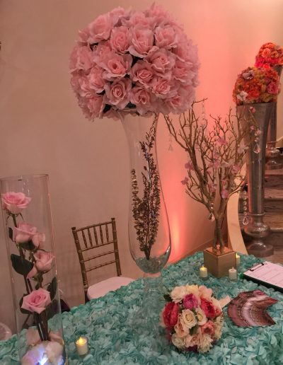 Wedding receptions pink roses in glass