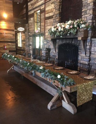 Wedding table covered in greenery