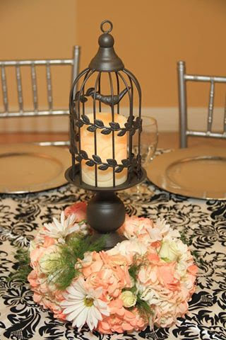 White and peach table arrangement with bird cage