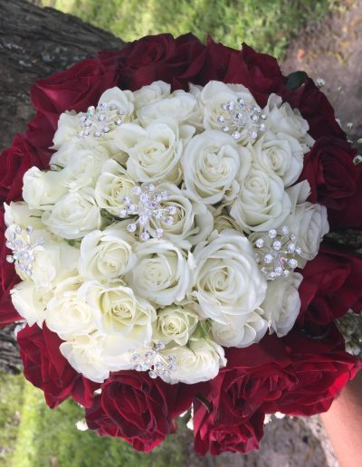 White and red roses in circle with diamonds bouquet