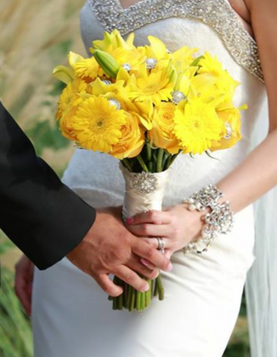 Yellow daisys and sunflowers with white pearls and silver bouquet for bride