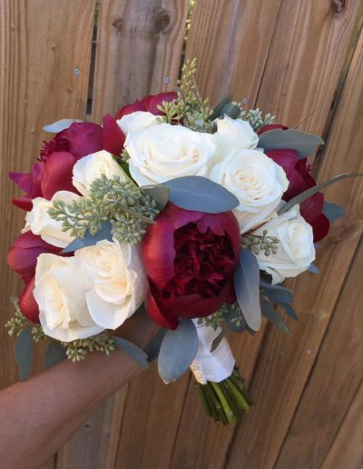 outdoor wedding bouquet white and red roses